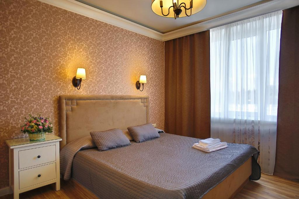 Кровать или кровати в номере Отель Южно-Приморский