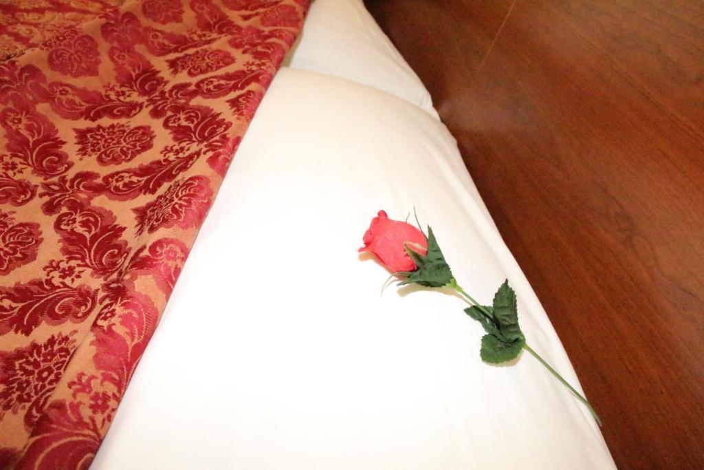 Letto o letti in una camera di Hotel Mirage