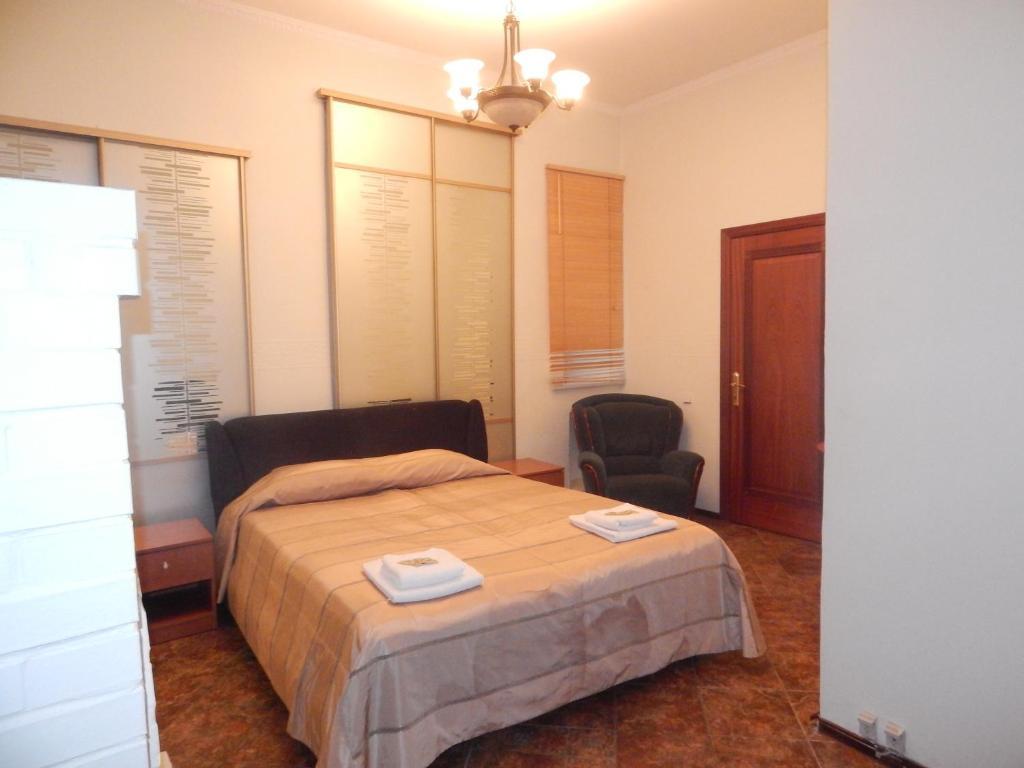 Кровать или кровати в номере Apartment Nika Nevsky 88
