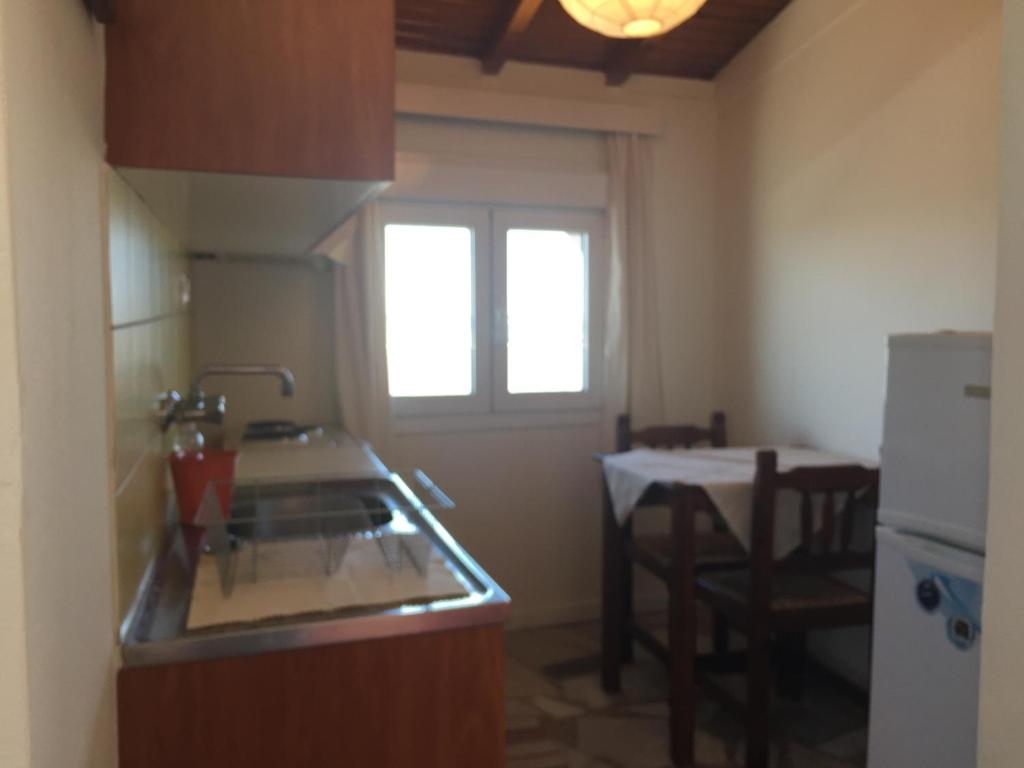 A kitchen or kitchenette at Popy Apartments