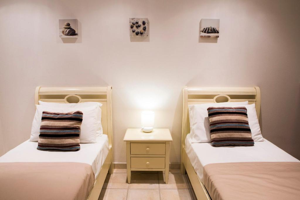 A bed or beds in a room at Villetta Venere