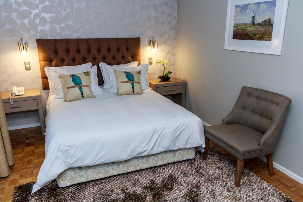 Кровать или кровати в номере Hotel Alonso de Ercilla