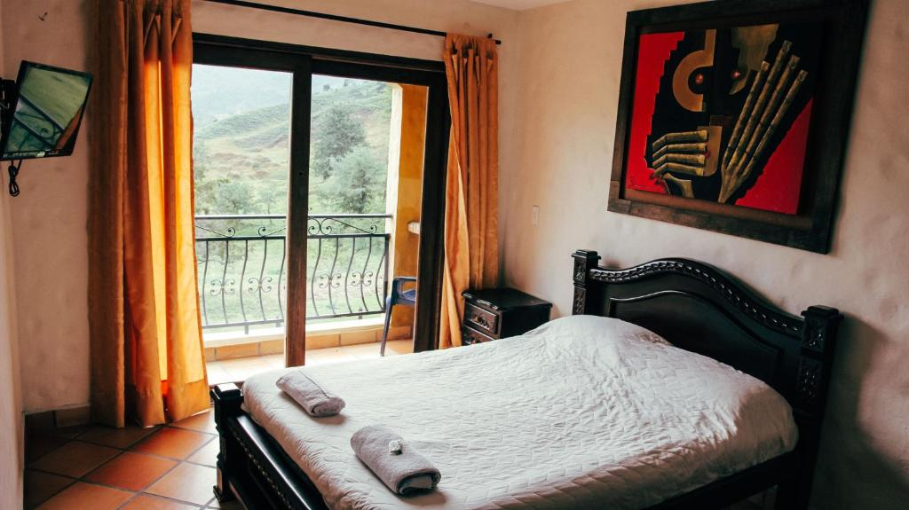 A bed or beds in a room at Lake View Hostel