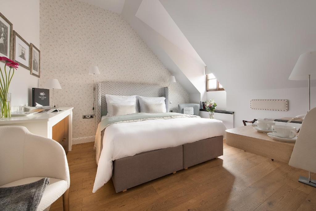 A bed or beds in a room at Design Hotel Neruda