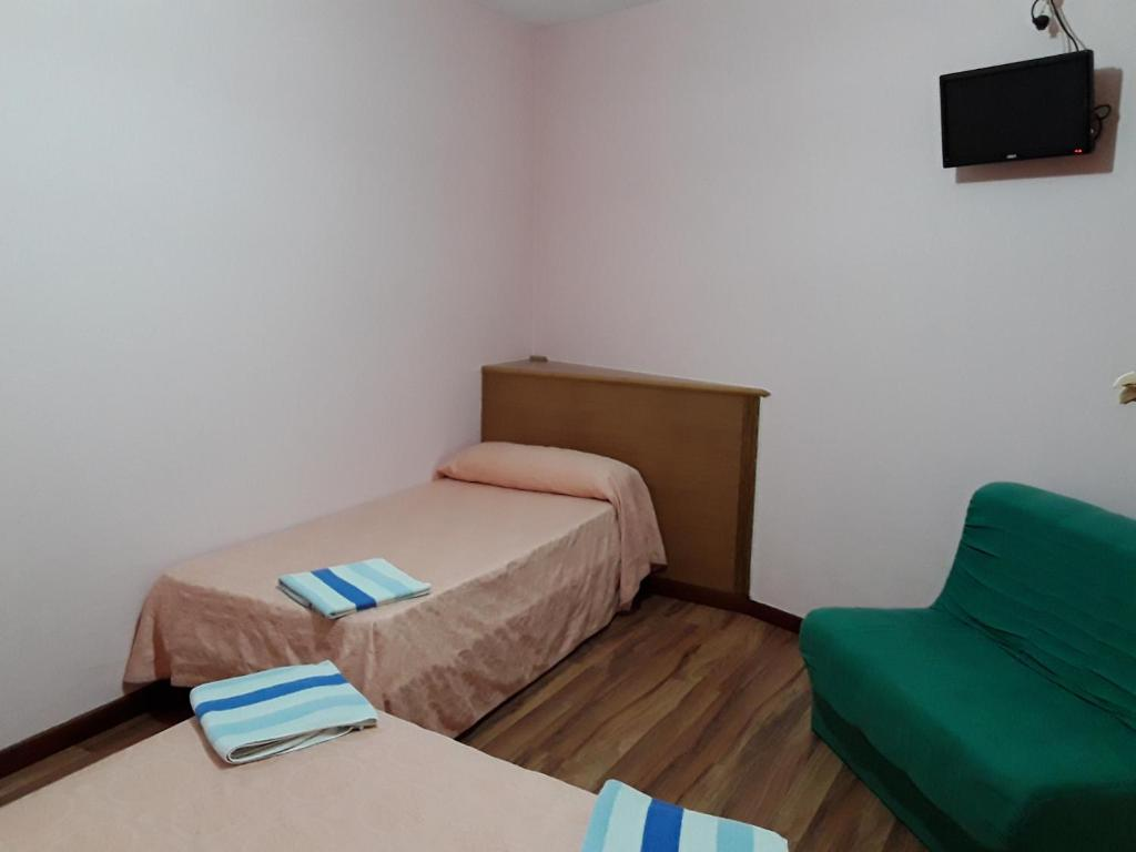 A bed or beds in a room at A Concha