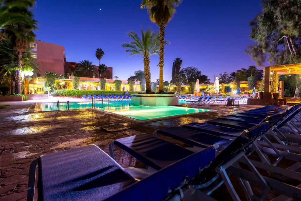 The swimming pool at or near Hôtel Farah Marrakech