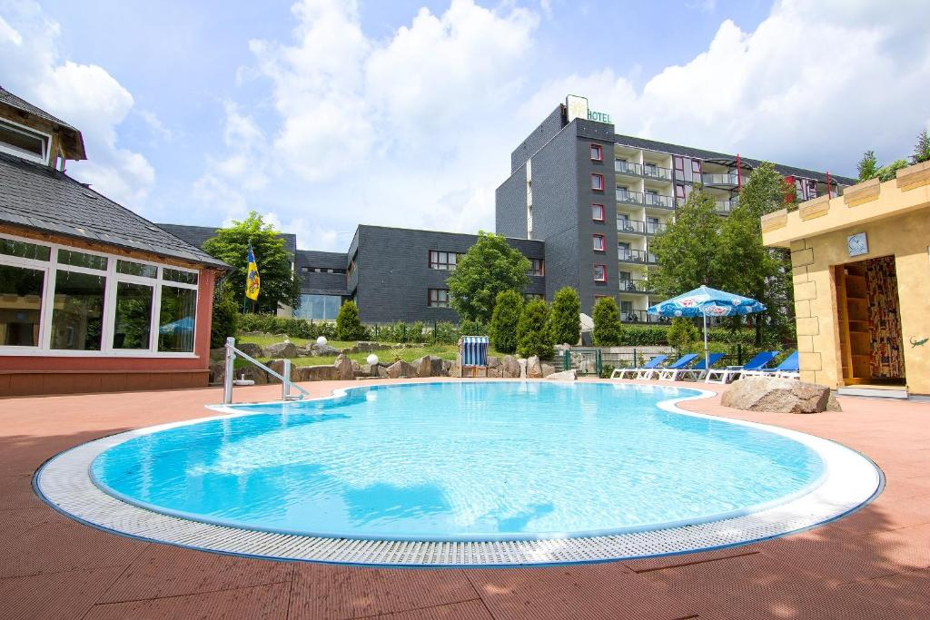 The swimming pool at or near Aparthotel am Rennsteig