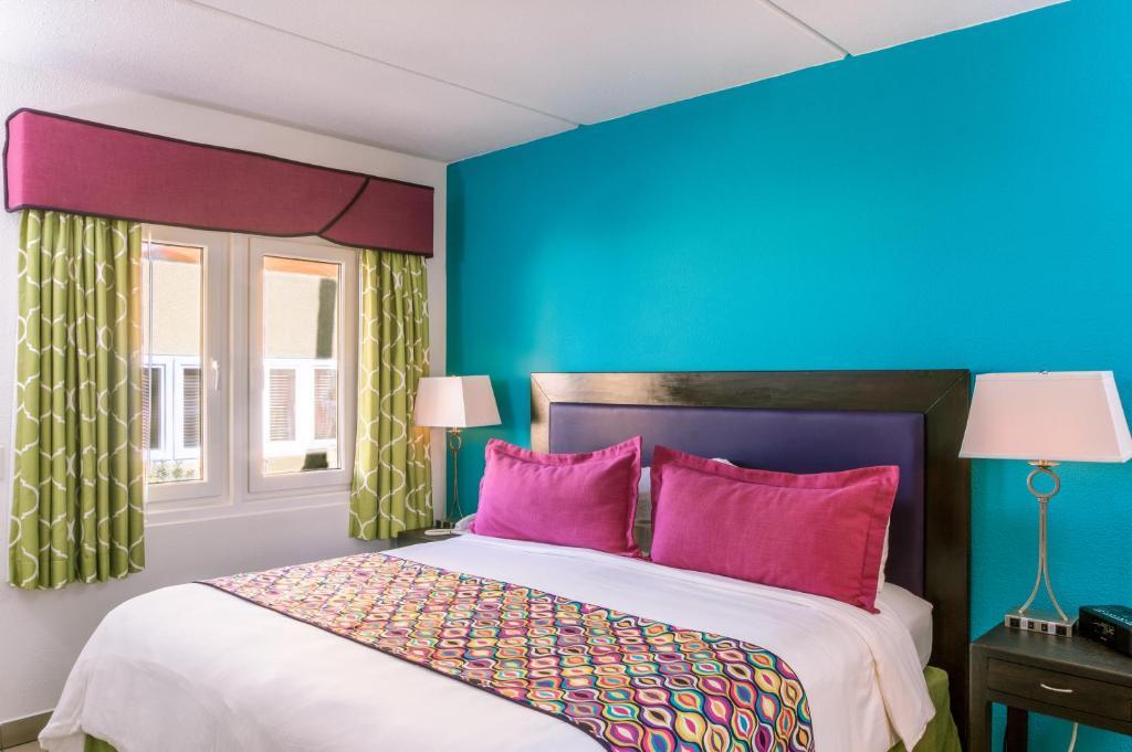 Cama ou camas em um quarto em MVC Eagle Beach