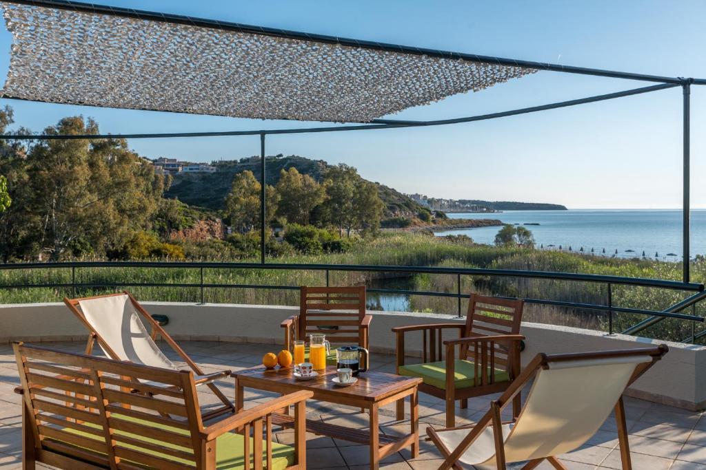 A balcony or terrace at Naiades Almiros Beach Villa