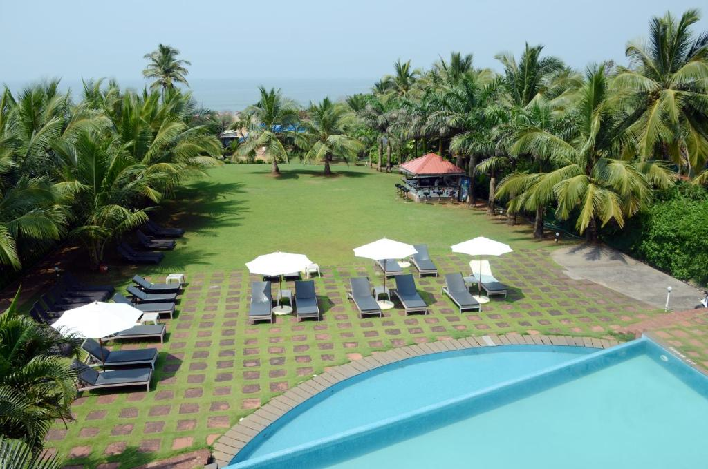 A view of the pool at The O Hotel Beach Resort & Spa, Goa or nearby