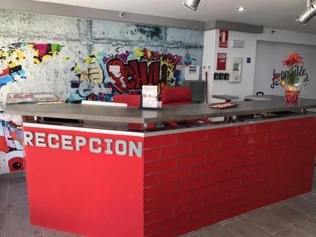 El vestíbulo o zona de recepción de New Art Hostel - Albergue Juvenil