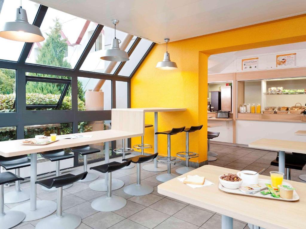 Restaurant ou autre lieu de restauration dans l'établissement hotelF1 Vesoul