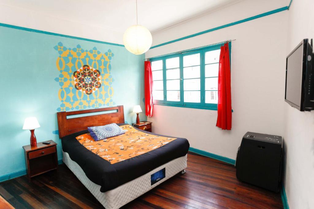 Cama o camas de una habitación en Casa Violeta Limón