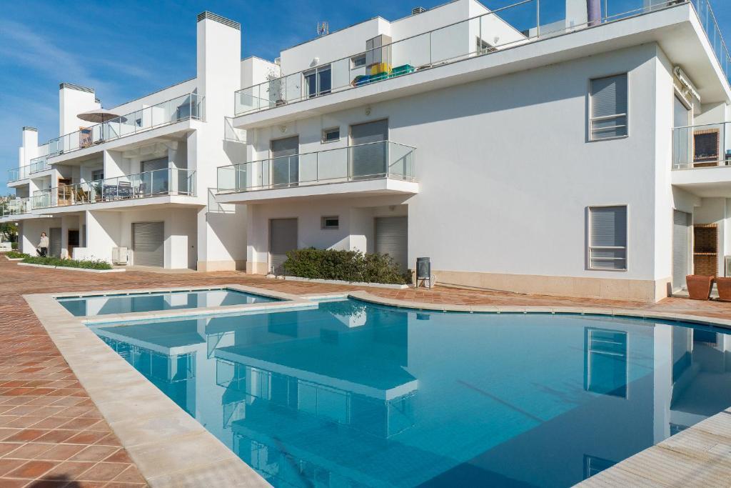 The swimming pool at or near BmyGuest - Santa Luzia Beach Apartments