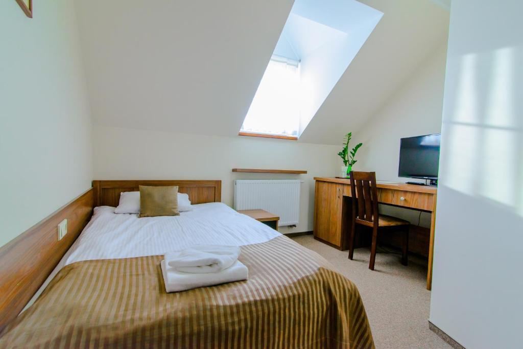 Łóżko lub łóżka w pokoju w obiekcie Noclegi Sobańskich