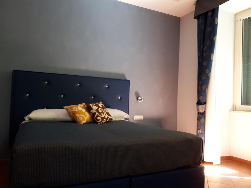 Cama o camas de una habitación en Clodio Rooms