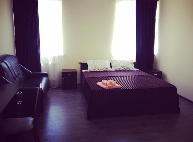 Кровать или кровати в номере Гостиница Изобильный