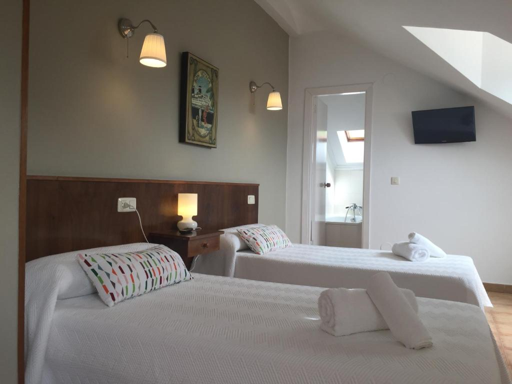 A bed or beds in a room at Hotel Arena