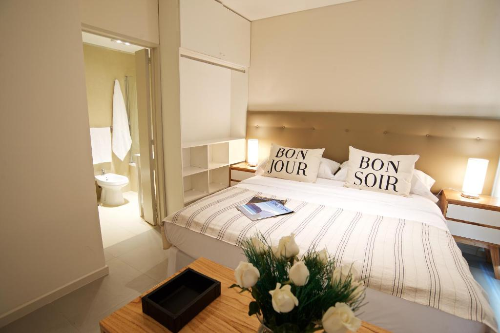 A bed or beds in a room at Bonjour My Vera