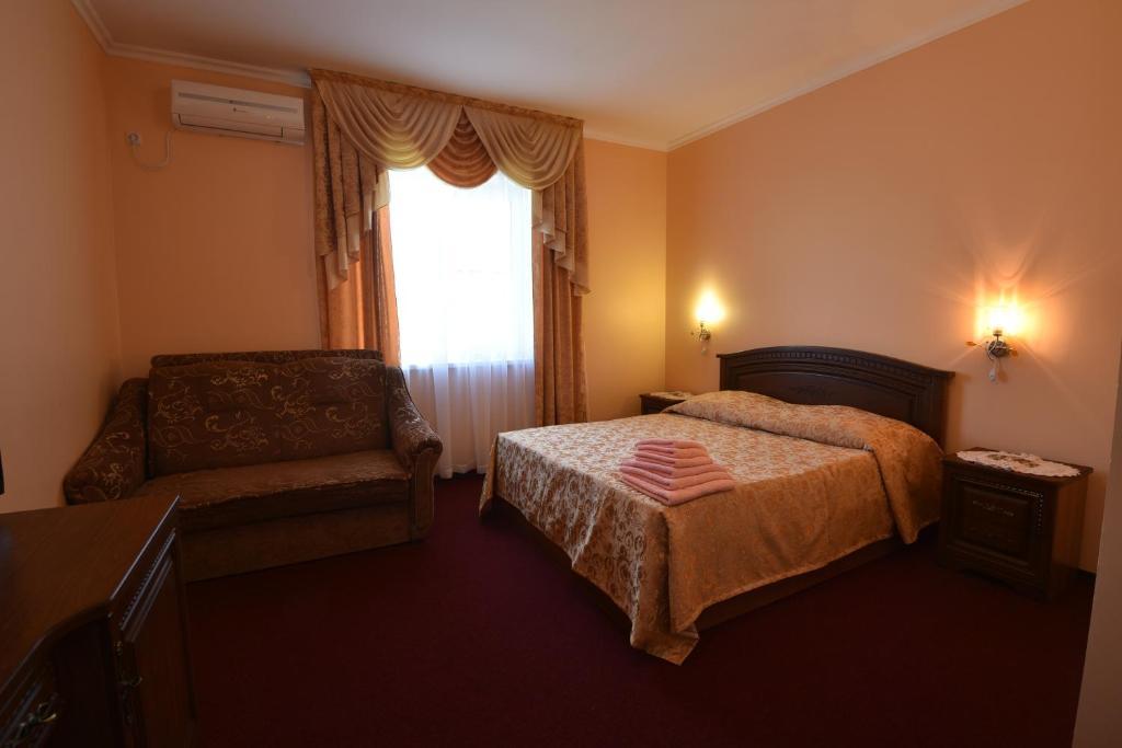 Кровать или кровати в номере Malenkaya Gagra