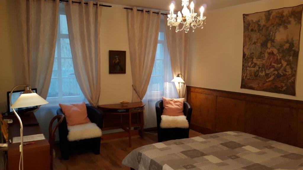 Ein Bett oder Betten in einem Zimmer der Unterkunft Altstadtapartment Rochusstraße