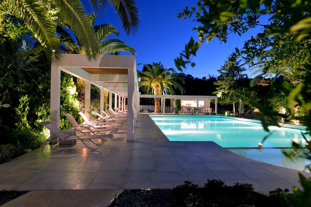 The swimming pool at or near Corfu Palma Boutique Hotel - Service Excellence
