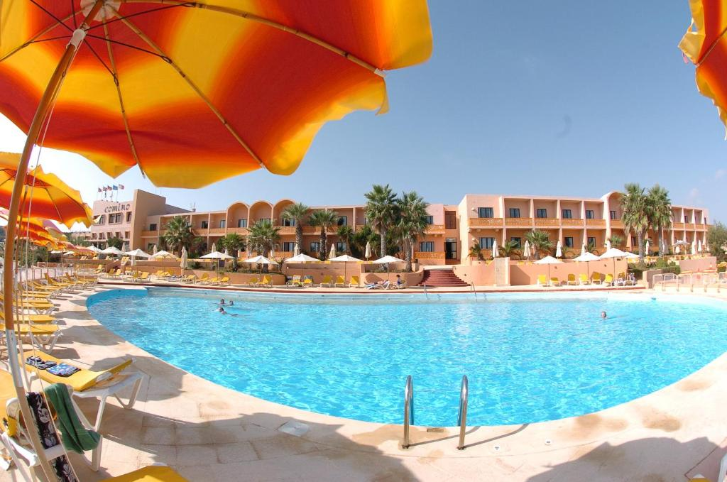 The swimming pool at or near Comino Hotel