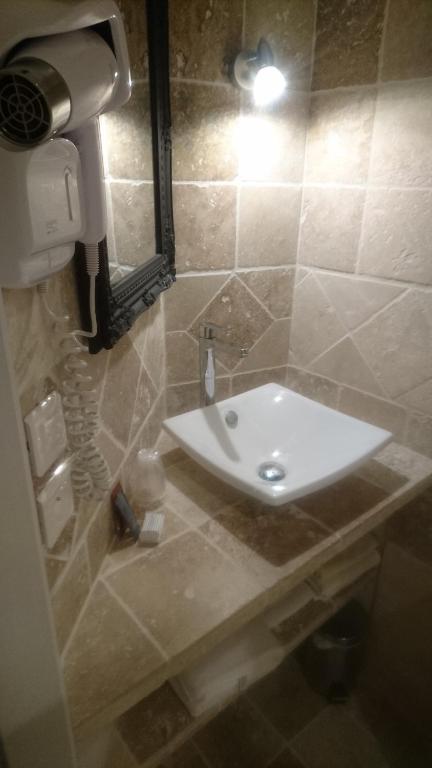 Salle de bains dans l'établissement Le Grand Hotel