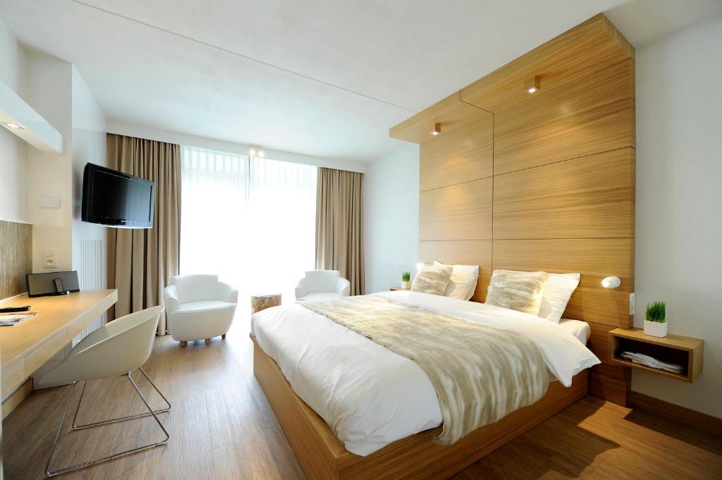 Кровать или кровати в номере Van der Valk Hotel Beveren