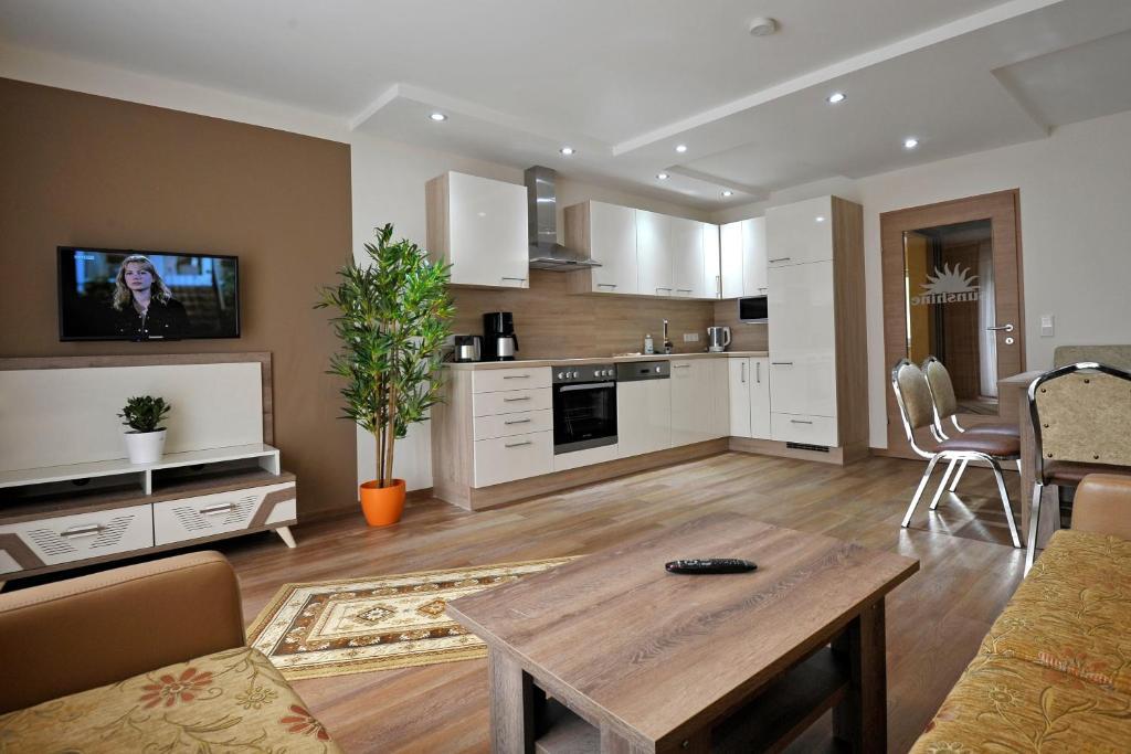 Kuchyň nebo kuchyňský kout v ubytování Sunshine Apartments - Great Mountain View
