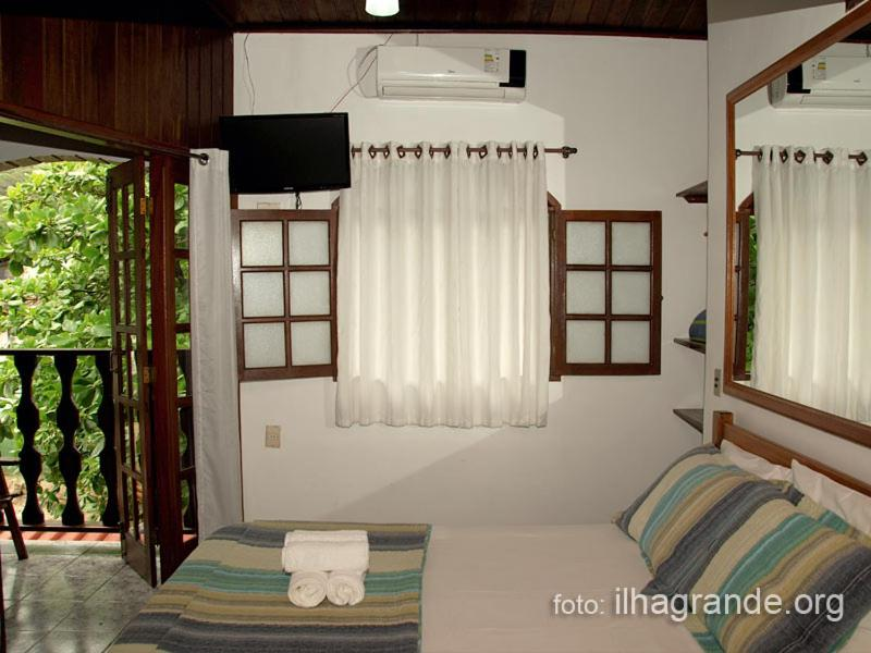 A bed or beds in a room at Pousada Juliana
