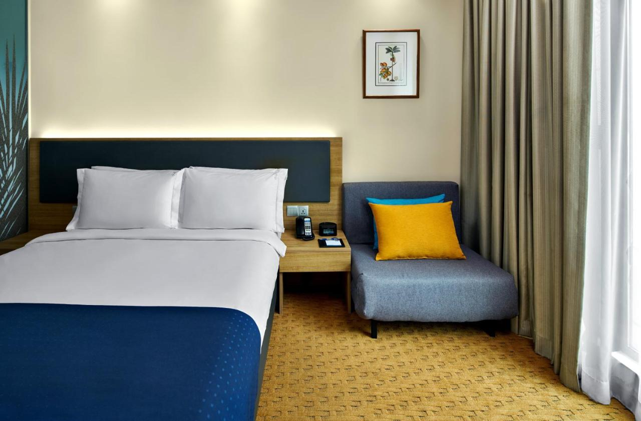 Holiday Inn Express SINGAPORE ORCHARD ROAD - Laterooms