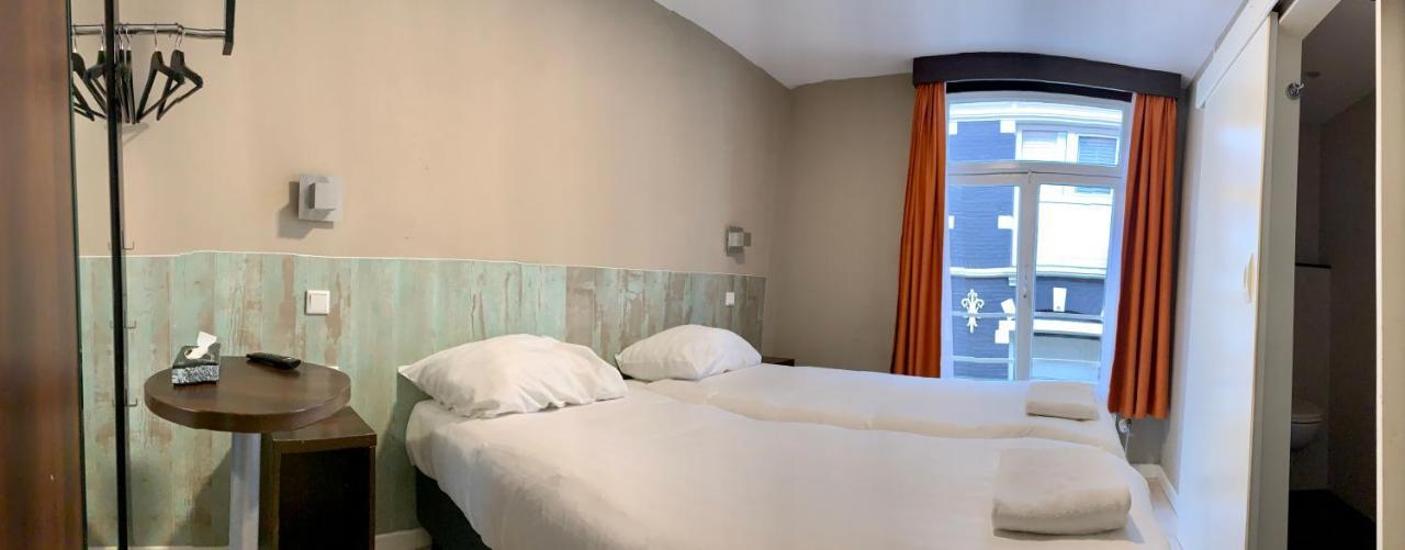 Damrak Inn Hotel - Laterooms
