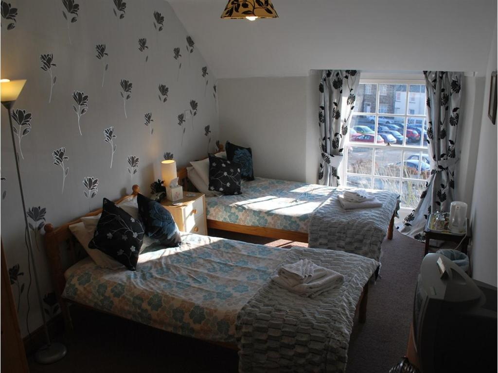 College Guest House - Laterooms