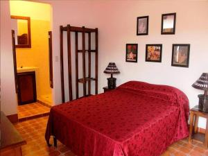 A bed or beds in a room at Boutique Hotel Maharaja