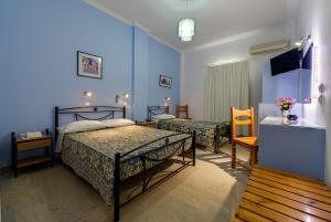 Ένα ή περισσότερα κρεβάτια σε δωμάτιο στο Akis Hotel