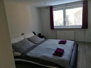 Posteľ alebo postele v izbe v ubytovaní Apartman Prievidza-Bojnice