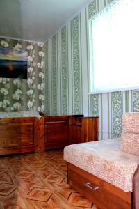 Кровать или кровати в номере Гостевой дом Татьяна