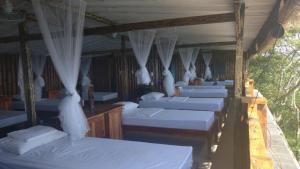 Posteľ alebo postele v izbe v ubytovaní Ciao Hostel