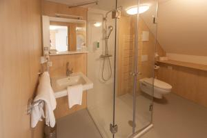 Ванная комната в Pension & Reitstall Inghofer