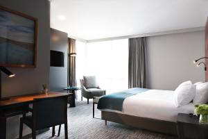 A bed or beds in a room at Atix Hotel