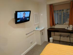 A television and/or entertainment centre at The Kelvin Hotel West End