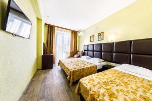 Кровать или кровати в номере Отель Санрайз
