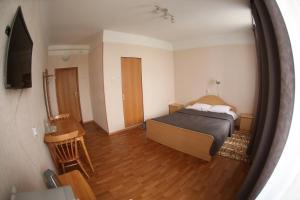 Кровать или кровати в номере Hotel Moneron
