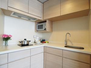 A kitchen or kitchenette at Garden View Hong Kong