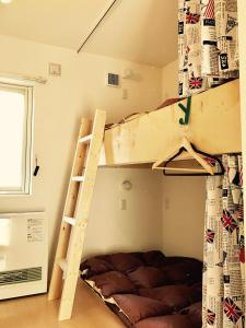 A bunk bed or bunk beds in a room at Guest House On My Way