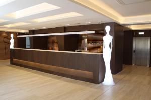 The lobby or reception area at Hotel Checkin Flamingo