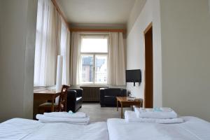 Postel nebo postele na pokoji v ubytování Hotel Praha Liberec