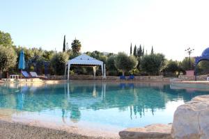 The swimming pool at or near Hotel de Charme Capela das Artes