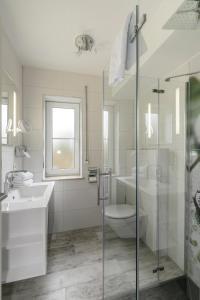 Ein Badezimmer in der Unterkunft Seehotel Michaela